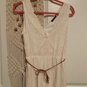 White romper with thin braided tan belt
